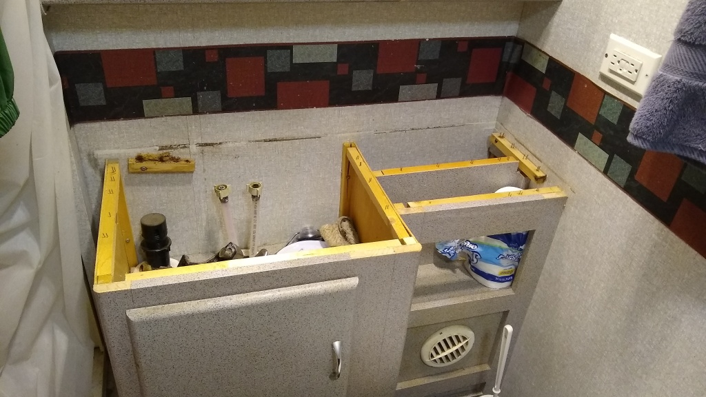 Removing the bathroom vanity top